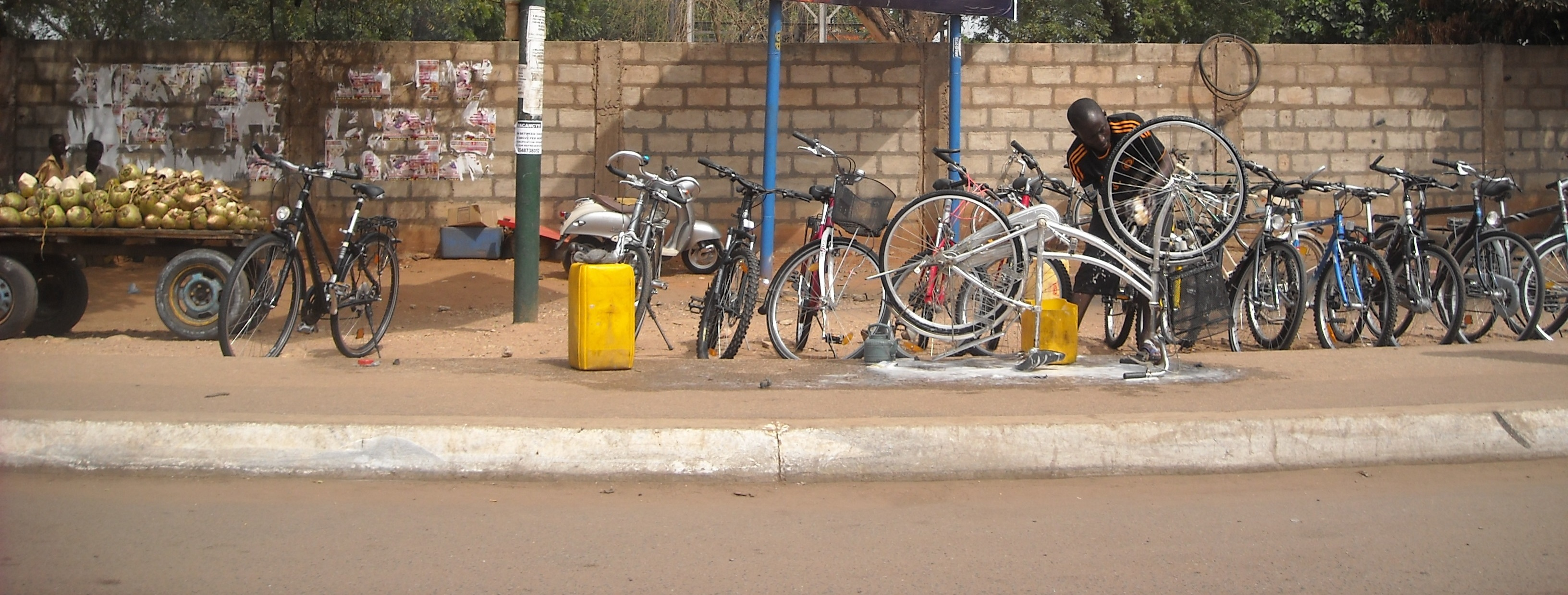Bicycle seller and repairman, Mamobi, Accra, Ghana.