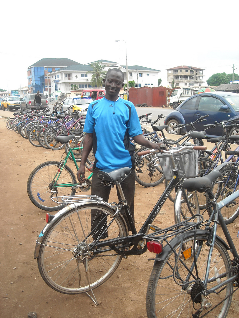 Vendor selling secondhand bikes in Maamobi, Accra, Ghana. In certain areas of Accra, it's common to see vendors set up shop along the roads to sell bicycles, many imported from Europe and the United States.
