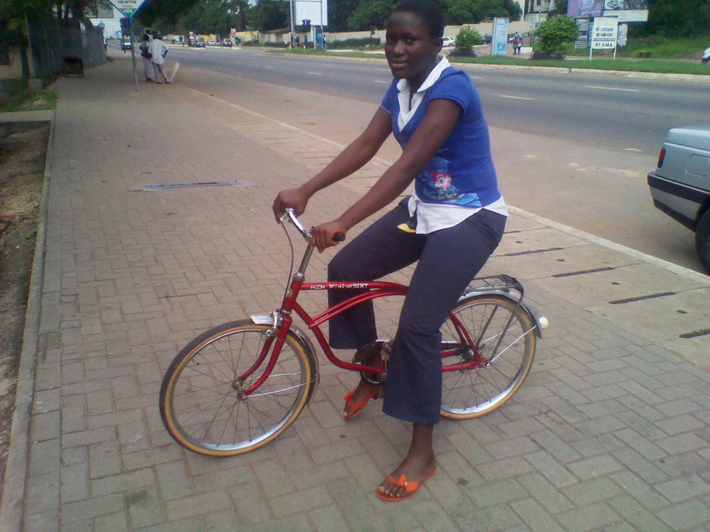 Abigail, 15, riding her bicycle around the East Airport area in Accra. Of bicyclists in the city, few are female.