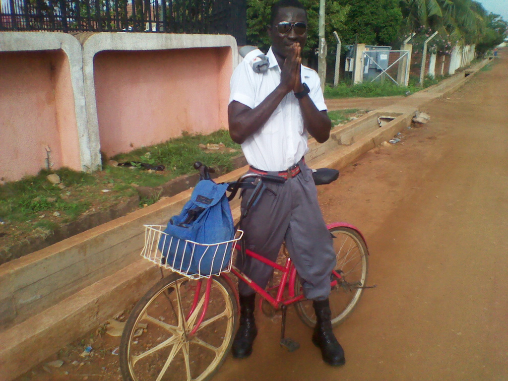 In East Legon, a security guard takes a moment to show off his ride.