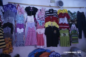 Children's clothes for sale at Kantamanto Market.