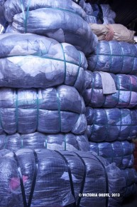 Plastic-wrapped packages of imported clothes, to go on sale at Kantamanto Market.