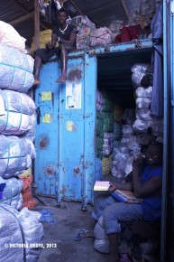 Nasiruwa's space in Kantamanto, an immense container where he rents out space for vendors' packages of clothes.