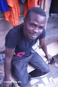 Boadi, who sells men's football shoes at Kantamanto, has worked in both the inner section of the market, and now the outer section, where he says he has access to more customers.