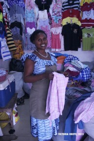 Sophia sells women's and children's clothes at Kantamanto Market, in Accra, Ghana.
