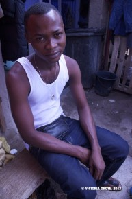 Yaw Intim, who works with his colleague Boadi in selling man's shoes.