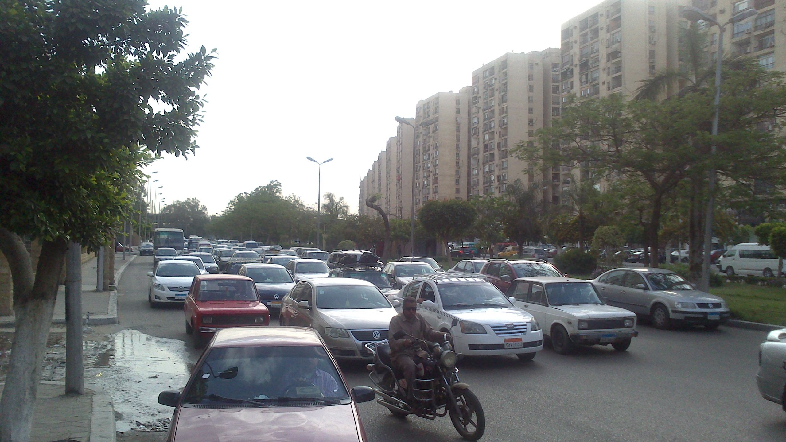 Road congestion on Cairo's streets, and a motorcyclist aims to beat the traffic.