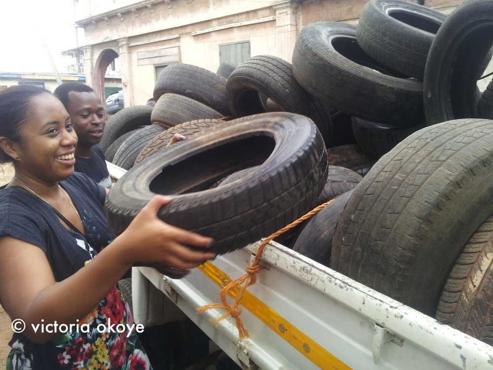 Mae-Ling Lokko, our teammate, helps unload tires.