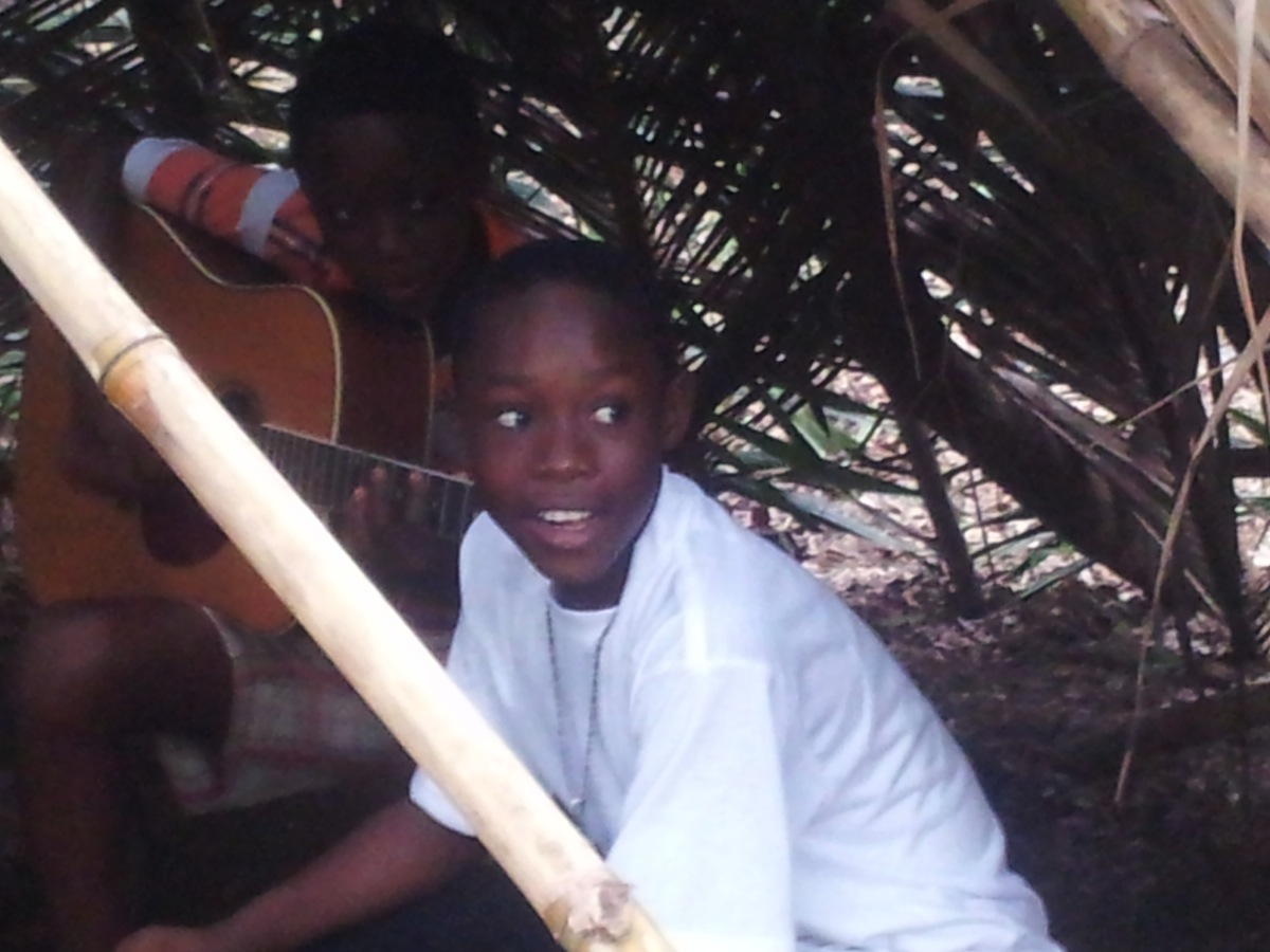 Boys in a hut at Mmofra Foundation's Playtime Park.