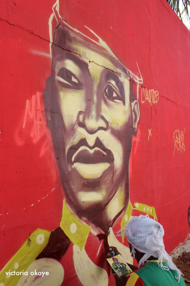 A graffiti artist recreates the bust of Thomas Sankara on a wall at Biscuterie de Médina in Dakar, Senegal as part of Festigraff 2014.
