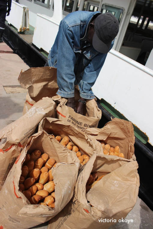 Bread, fresh off the ferry, to be sold to businesses and customers at Gorée Island.