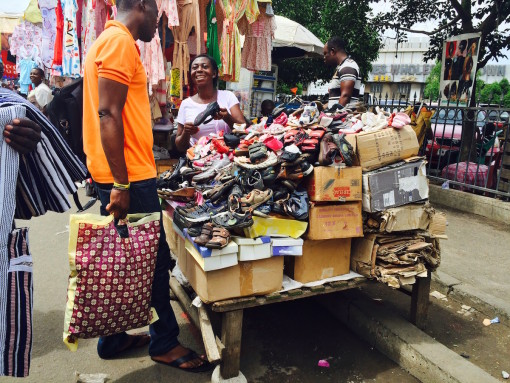 It's Saturday morning and Kwame Nkrumah Avenue, a high-traffic and high-commerce road that links Accra's Kantamanto and Makola Markets, is bustling.